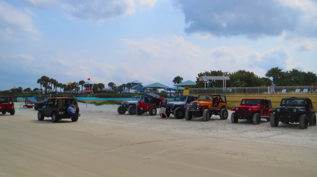 Jeeps driving on the beach 2