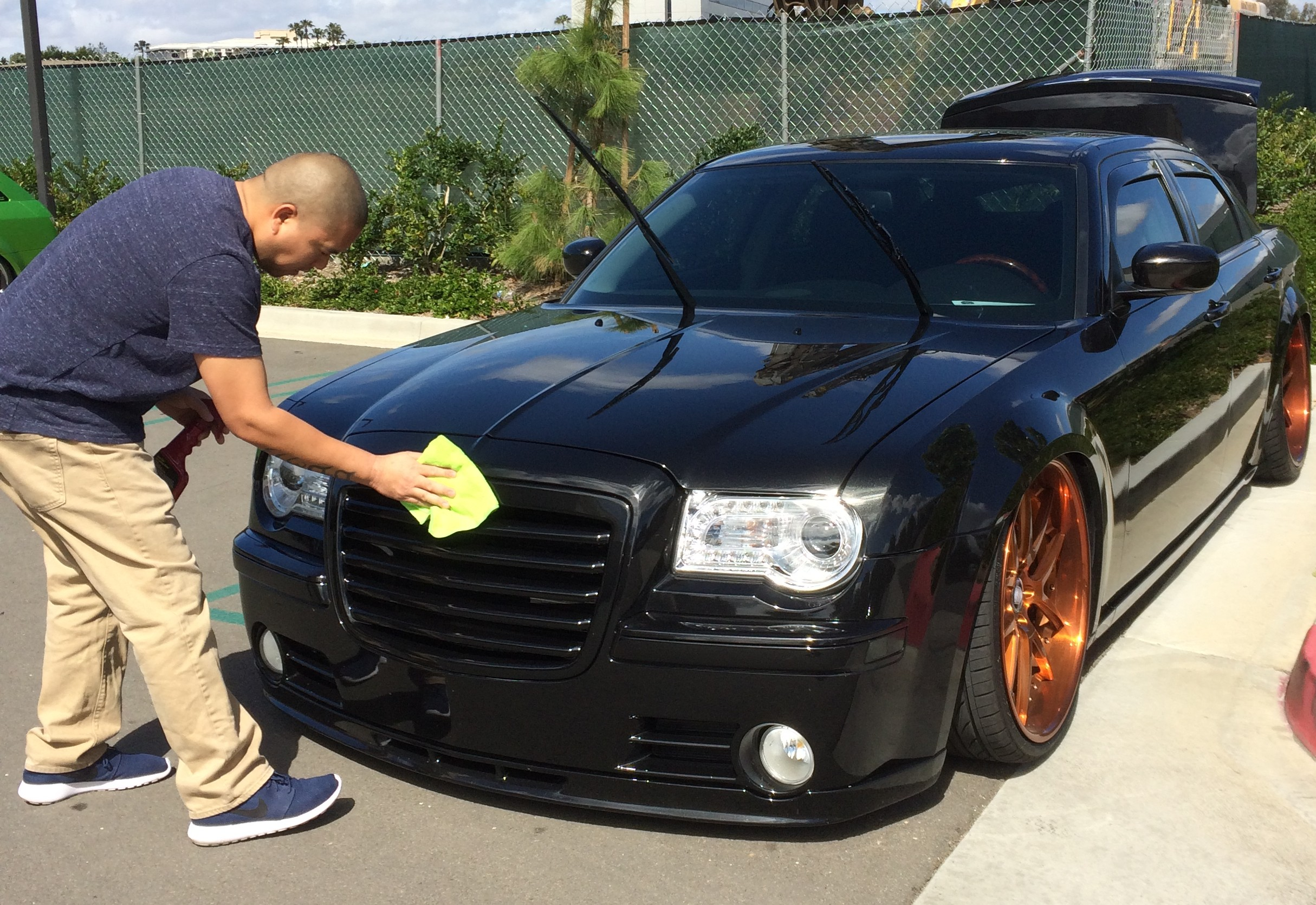 Ron Rodriguez cleans up his Chrysler 300C.