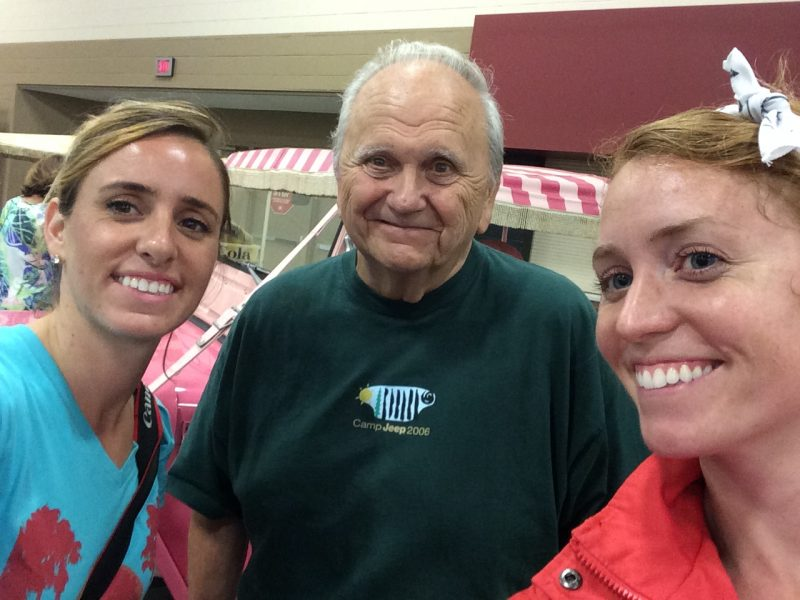 Brittany (left) and Ashley Hill with Jeep historian Ron Szymanski.