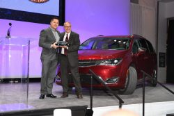 Timothy Kuniskis head of Passenger Car Brands for FCA accepts the award for the Chrysler Pacifica minivan from Matt DeLorenzo, Vice President NACTOY . The Pacifica was named North American Utility Vehicle of the year at the North American International Auto Show, Monday, January 9, 2017 in Detroit