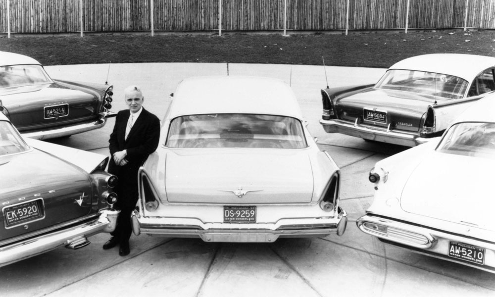 Virgil Exner with the 1957 models.
